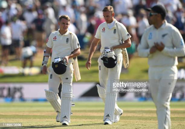 Sam Curran and Stuart Broad of England leave the field after New Zealand won the first Test match between New Zealand and England at Bay Oval on...