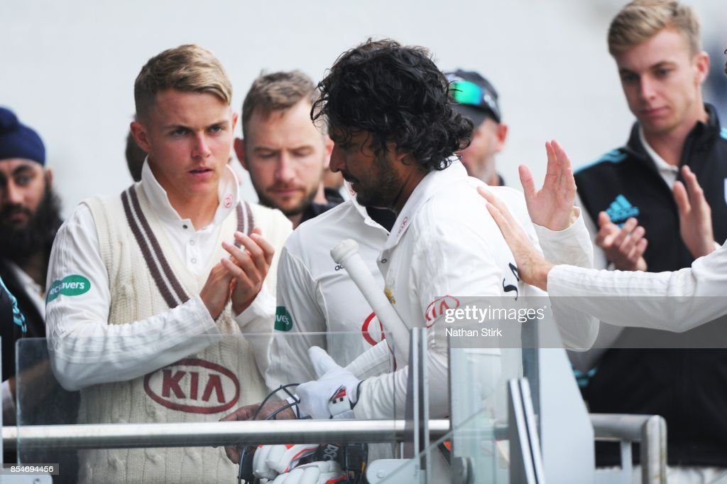 Sam Curran claps Kumar Sangakkara of Surrey as he goes back to the changing rooms during the County Championship Division One match between Lancashire and Surrey at Old Trafford on September 27, 2017 in Manchester, England.