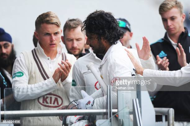Sam Curran claps Kumar Sangakkara of Surrey as he goes back to the changing rooms during the County Championship Division One match between...