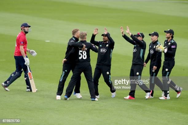 Sam Curran is congratulated by his Surrey team having dismissed Nick Browne during the Surrey v Essex Royal London OneDay Cup at the Kia Oval Cricket...