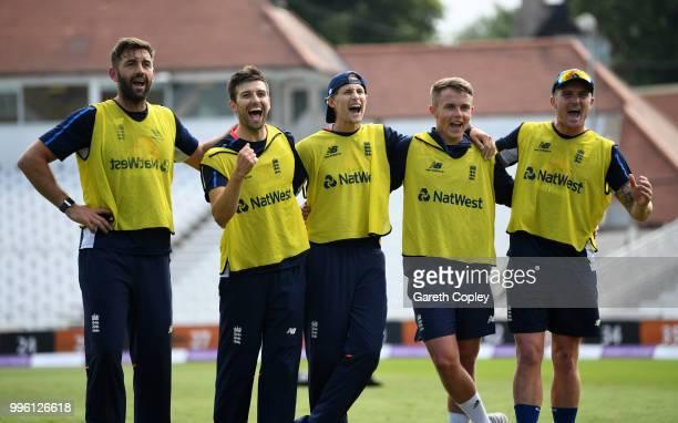 Sam Curran Mark Wood Joe Root Jason Roy and Liam Plunkett of England celebrate winning a pre nets session football match at Trent Bridge on July 11...