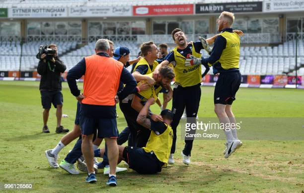Sam Curran Mark Wood Jos Buttler Jason Roy and Liam Plunkett of England celebrate winning a pre nets session football match at Trent Bridge on July...