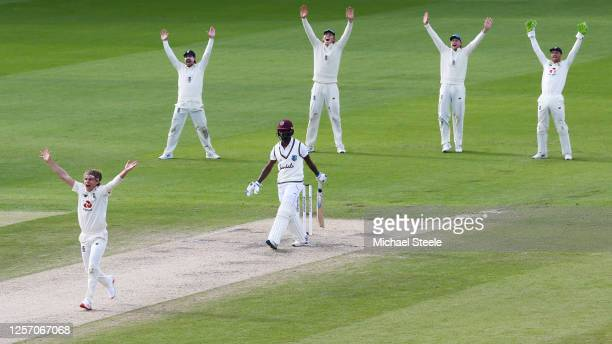 Sam Curran of England appeals unsuccessfully for the wicket of Kemar Roach of West Indies with Rory Burns, Zak Crawley, Joe Root and Jos Buttler...