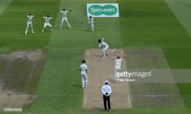 Sam Curran of England celebrates after dismissing Lokesh Rahul of India during the second day of the 1st Specsavers Test Match between England and...