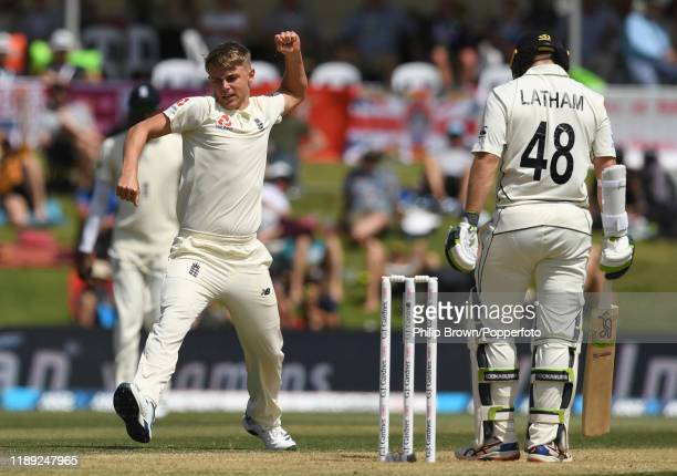 Sam Curran of England celebrates after dismissing Tom Latham of New Zealand during day two of the first Test match between New Zealand and England at...