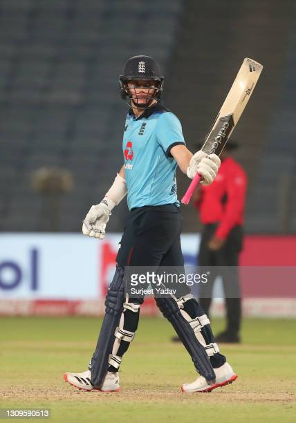 Sam Curran of England celebrates after reaching their half century during the 3rd One Day International match between India and England at MCA...