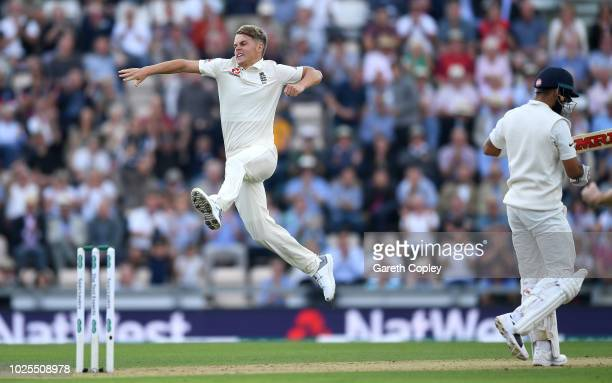 Sam Curran of England celebrates dismissing India captain Virat Kohli during day two of the Specsavers 4th Test match between England and India at...