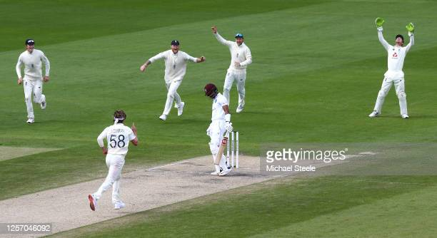 Sam Curran of England celebrates taking the wicket of Shai Hope of West Indies caught by Jos Buttler of England with Zak Crawley , Ben Stokes and Joe...