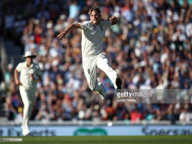 Sam Curran of England celebrates taking the wicket of Tim Paine of Australia during day two of the 5th Specsavers Ashes Test match between England...