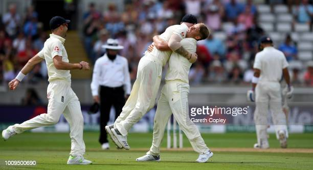 Sam Curran of England celebrates with Ben Stokes after dismissing Shikhar Dhawan of India during day two of the Specsavers 1st Test between England...