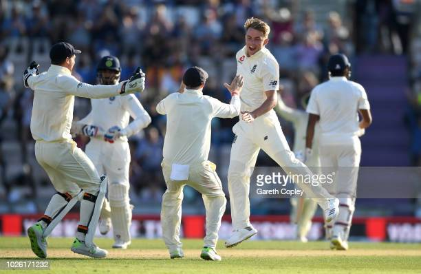 Sam Curran of England celebrates with captain Joe Root and Jos Buttler after dismissing Ravichandran Ashwin of India to win the Specsavers 4th Test...