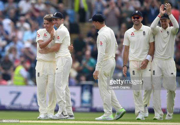Sam Curran of England celebrates with Chris Woakes after dismissing Shadab Khan of Pakistan during the 2nd NatWest Test match between England and...