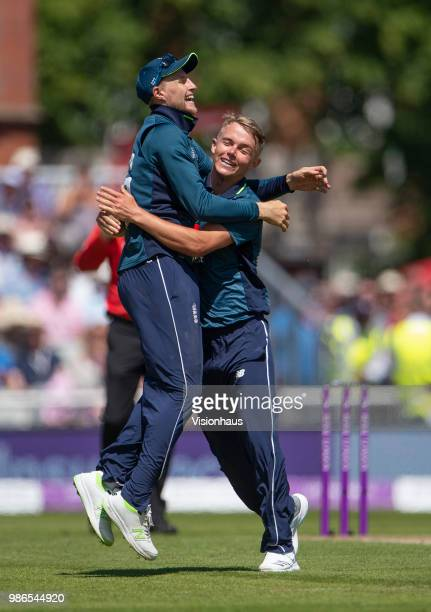 Sam Curran of England celebrates with Joe Root after taking the wicket of Alex Carey of Australia during the 5th Royal London ODI between England and...