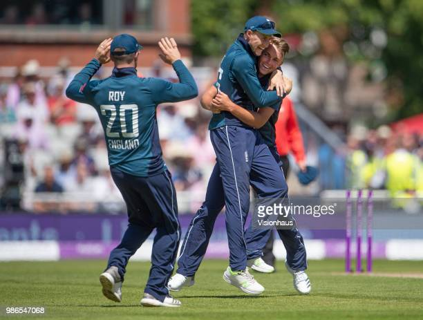 Sam Curran of England celebrates with Joe Root and Jason Roy after taking the wicket of Alex Carey of Australia during the 5th Royal London ODI...