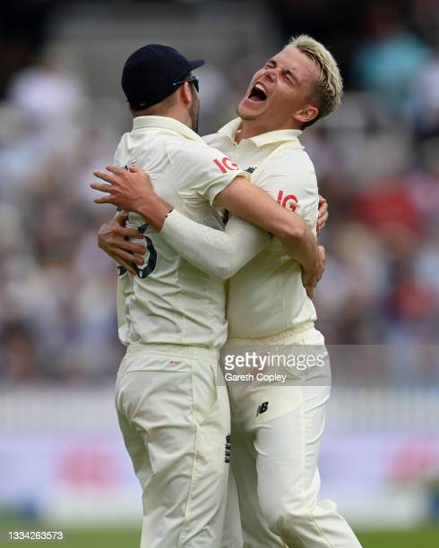 Sam Curran of England celebrates with Mark Wood after dismissing India captain Virat Kohli during day four of the Second LV= Insurance Test Match...