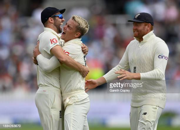 Sam Curran of England celebrates with Mark Wood and Jonathan Bairstow after dismissing India captain Virat Kohli during day four of the Second LV=...