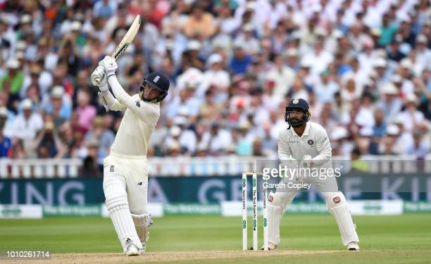 Sam Curran of England hits out for six runs watched India wicketkeeper Dinesh Karthik during day three of Specsavers 1st Test match between England...