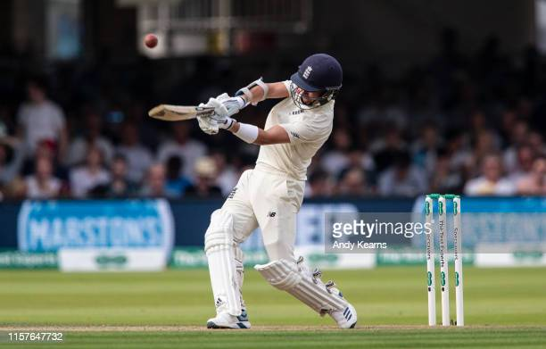 Sam Curran of England hits the ball to the boundary for four during day two of the Specsavers 1st Test match between England and Ireland at Lord's...