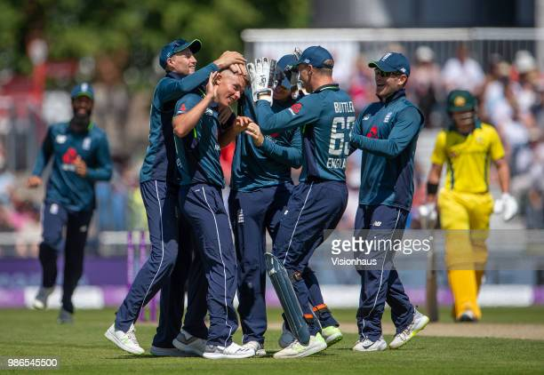 Sam Curran of England is congratulated by his team mates after taking the wicket of Alex Carey of Australia during the 5th Royal London ODI between...