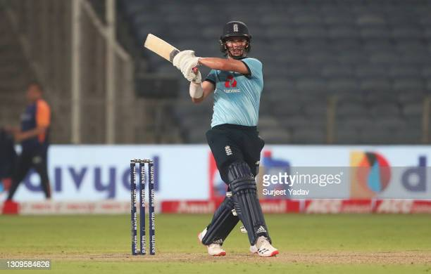 Sam Curran of England pulls the ball for a six during the 3rd One Day International match between India and England at MCA Stadium on March 28, 2021...