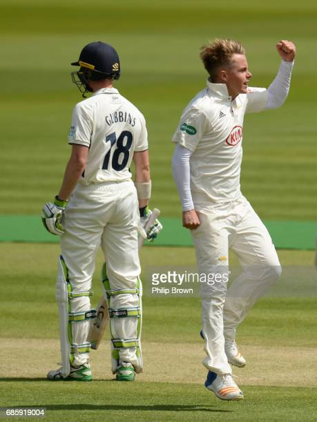 Sam Curran of Surrey celebrates after dismissing Nick Gubbins during day two of the Specsavers County Championship Division One cricket match between...