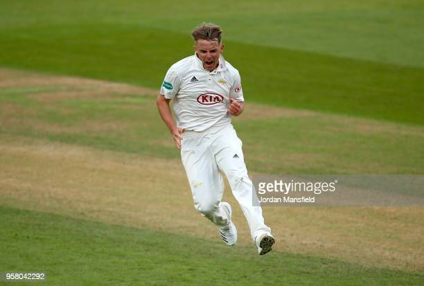 Sam Curran of Surrey celebrates dismissing Cheteshwar Pujara of Yorkshire during day three of the Specsavers County Championship Division One match...
