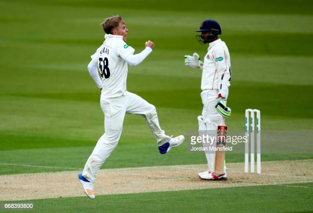 Sam Curran of Surrey celebrates getting the wicket of Haseeb Hameed of Lancashire during day one of the Specsavers County Championship Division One...