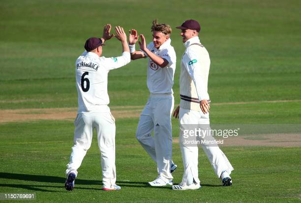 Sam Curran of Surrey celebrates with his teammates after dismissing Sean Dickson of Kent during day two of the Specsavers County Championship...