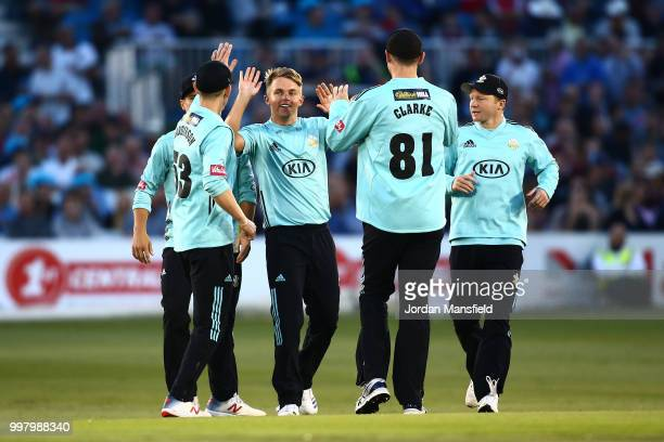 Sam Curran of Surrey celebrates with his teammates after dismissing Laurie Evans of Sussex during the Vitality Blast match between Sussex Sharks and...