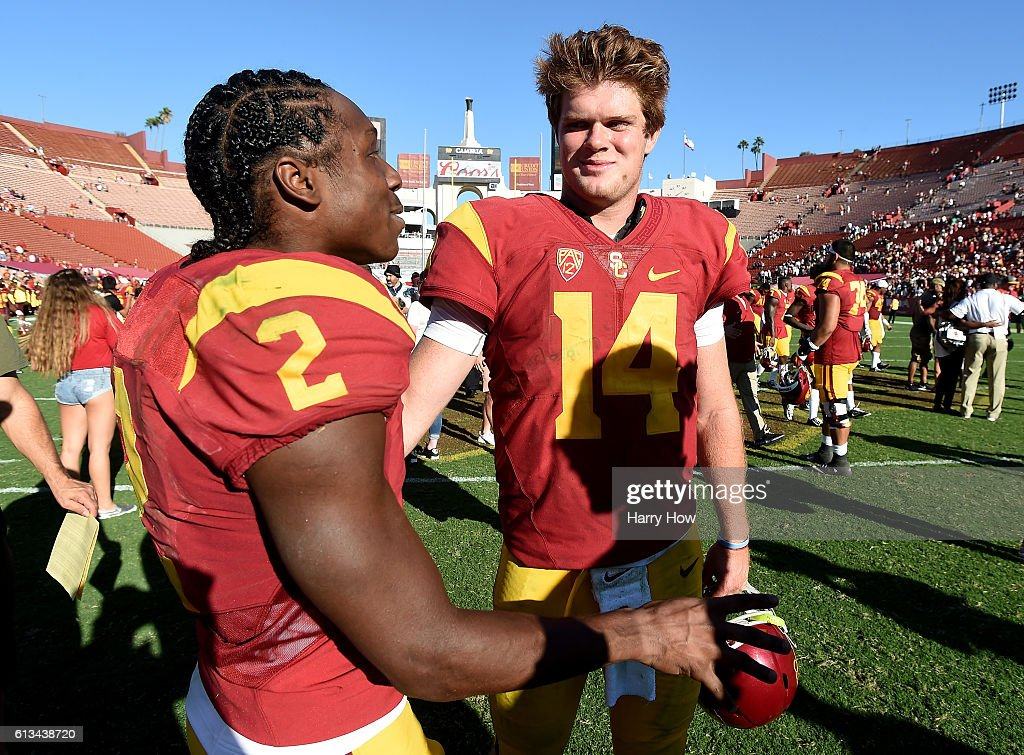 Sam Darnold #14 and Adoree' Jackson #2 of the USC Trojans celebrate a 21-17 win over the Colorado Buffaloes at Los Angeles Memorial Coliseum on October 8, 2016 in Los Angeles, California.