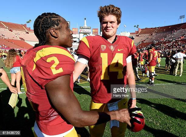 Sam Darnold and Adoree' Jackson of the USC Trojans celebrate a 2117 win over the Colorado Buffaloes at Los Angeles Memorial Coliseum on October 8...