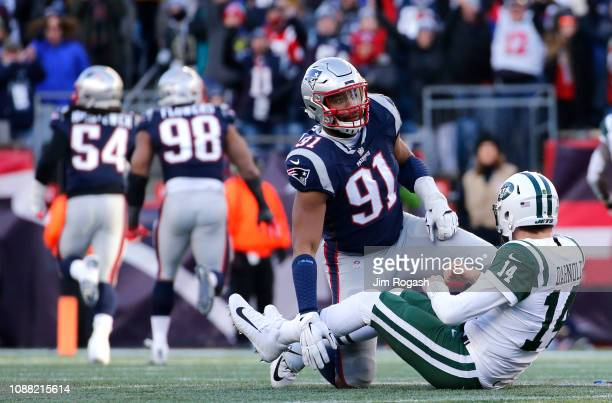 Sam Darnold of of the New York Jets reacts after a fumble caused by Deatrich Wise Jr #91 of the New England Patriots during the third quarter of a...