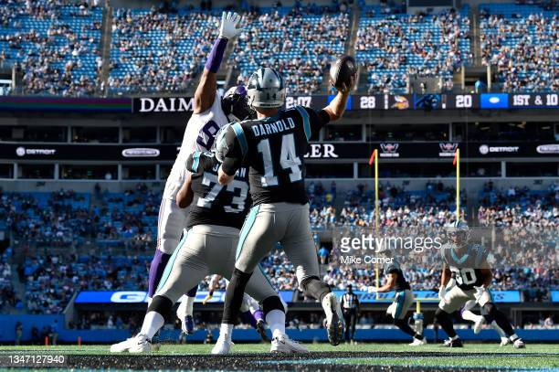 Sam Darnold of the Carolina Panthers attempts a pass against Dalvin Tomlinson of the Minnesota Vikings during the fourth quarter at Bank of America...
