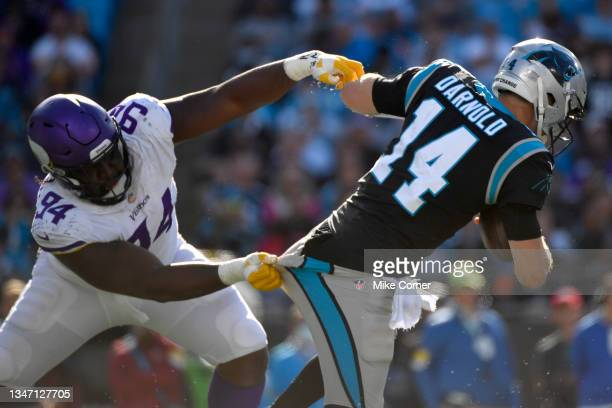 Sam Darnold of the Carolina Panthers escapes the tackle from Dalvin Tomlinson of the Minnesota Vikings during the second half at Bank of America...