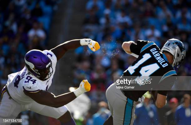 Sam Darnold of the Carolina Panthers escapes the tackle from Dalvin Tomlinson of the Minnesota Vikings during the fourth quarter at Bank of America...