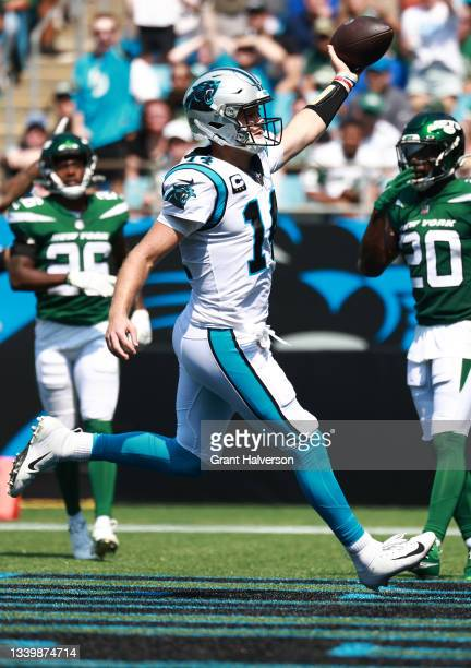 Sam Darnold of the Carolina Panthers runs for a five-yard touchdown during the second quarter against the New York Jets at Bank of America Stadium on...