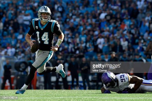 Sam Darnold of the Carolina Panthers runs out of the pocket during the fourth quarter against the Minnesota Vikings at Bank of America Stadium on...