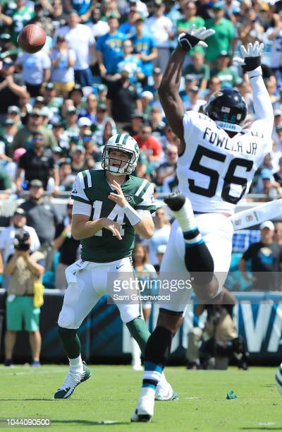 Sam Darnold of the New York Jets attempts a pass against Dante Fowler of the Jacksonville Jaguars during the game on September 30 2018 in...
