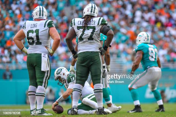Sam Darnold of the New York Jets gets up after being sacked against the Miami Dolphins at Hard Rock Stadium on November 4 2018 in Miami Florida