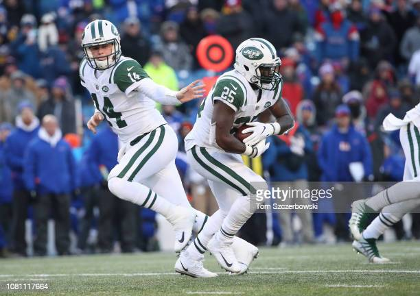 Sam Darnold of the New York Jets hands the ball off to Elijah McGuire in the fourth quarter during NFL game action against the Buffalo Bills at New...