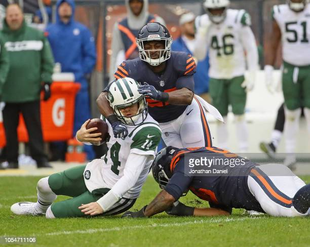 Sam Darnold of the New York Jets is brought down by Roy RobertsonHarris and Sherrick McManis of the Chicago Bears at Soldier Field on October 28 2018...