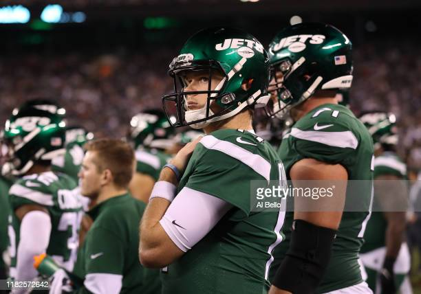 Sam Darnold of the New York Jets looks on during a 33-0 loss against the New England Patriots during their game at MetLife Stadium on October 21,...
