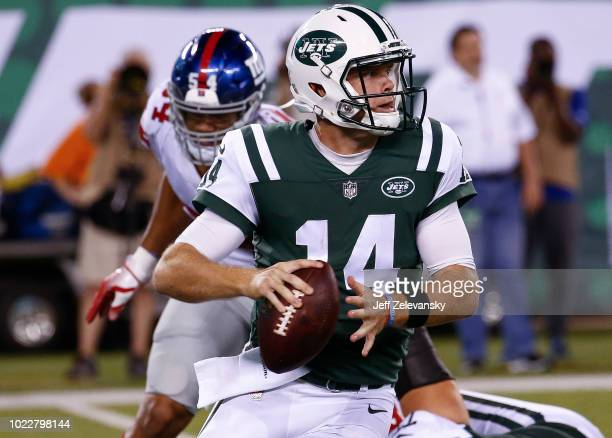 Sam Darnold of the New York Jets looks to pass against the New York Giants during their preseason game at MetLife Stadium on August 24 2018 in East...
