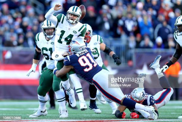 Sam Darnold of the New York Jets loses the football as he is tackled by Deatrich Wise Jr #91 of the New England Patriots during the third quarter of...