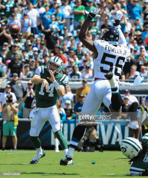 Sam Darnold of the New York Jets passes the ball around Dante Fowler Jr #56 of the Jacksonville Jaguars during the first half of the game between the...