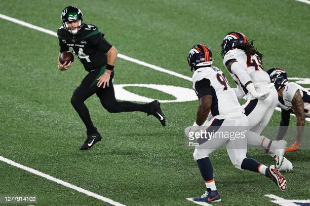 Sam Darnold of the New York Jets runs for a touchdown against the Denver Broncos during the first quarter at MetLife Stadium on October 01, 2020 in...