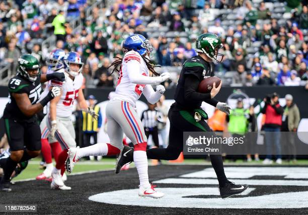 Sam Darnold of the New York Jets runs the ball into the end zone for a touchdown in the first quarter of their game against the New York Giants at...