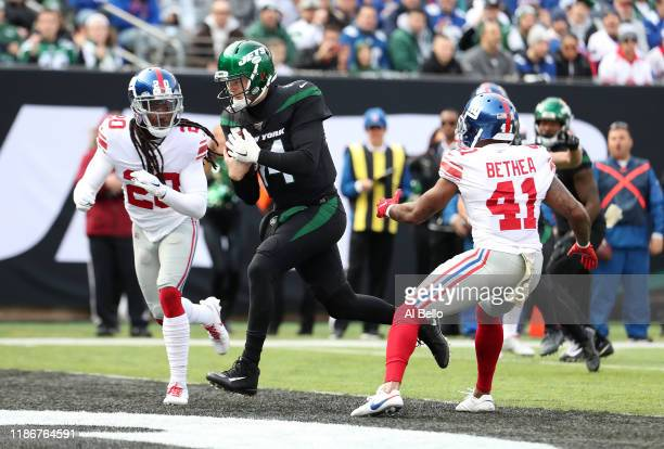 Sam Darnold of the New York Jets scores a first quarter touchdown against the New York Giants during their game at MetLife Stadium on November 10,...