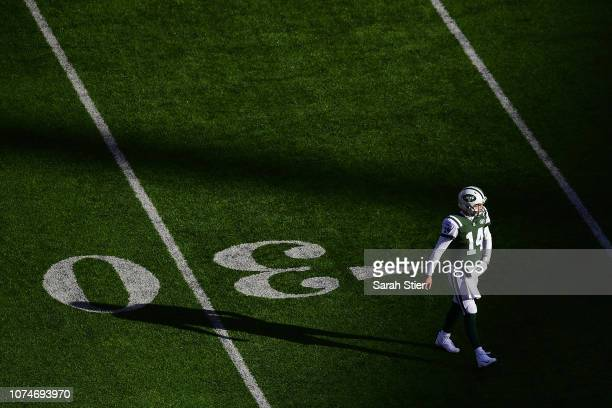Sam Darnold of the New York Jets walks off the field during the game against the Green Bay Packers in the first quarter at MetLife Stadium on...