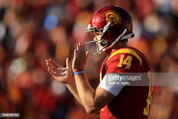 Sam Darnold of the USC Trojans claps during the first half of a game against the Stanford Cardinal at Los Angeles Memorial Coliseum on September 9...